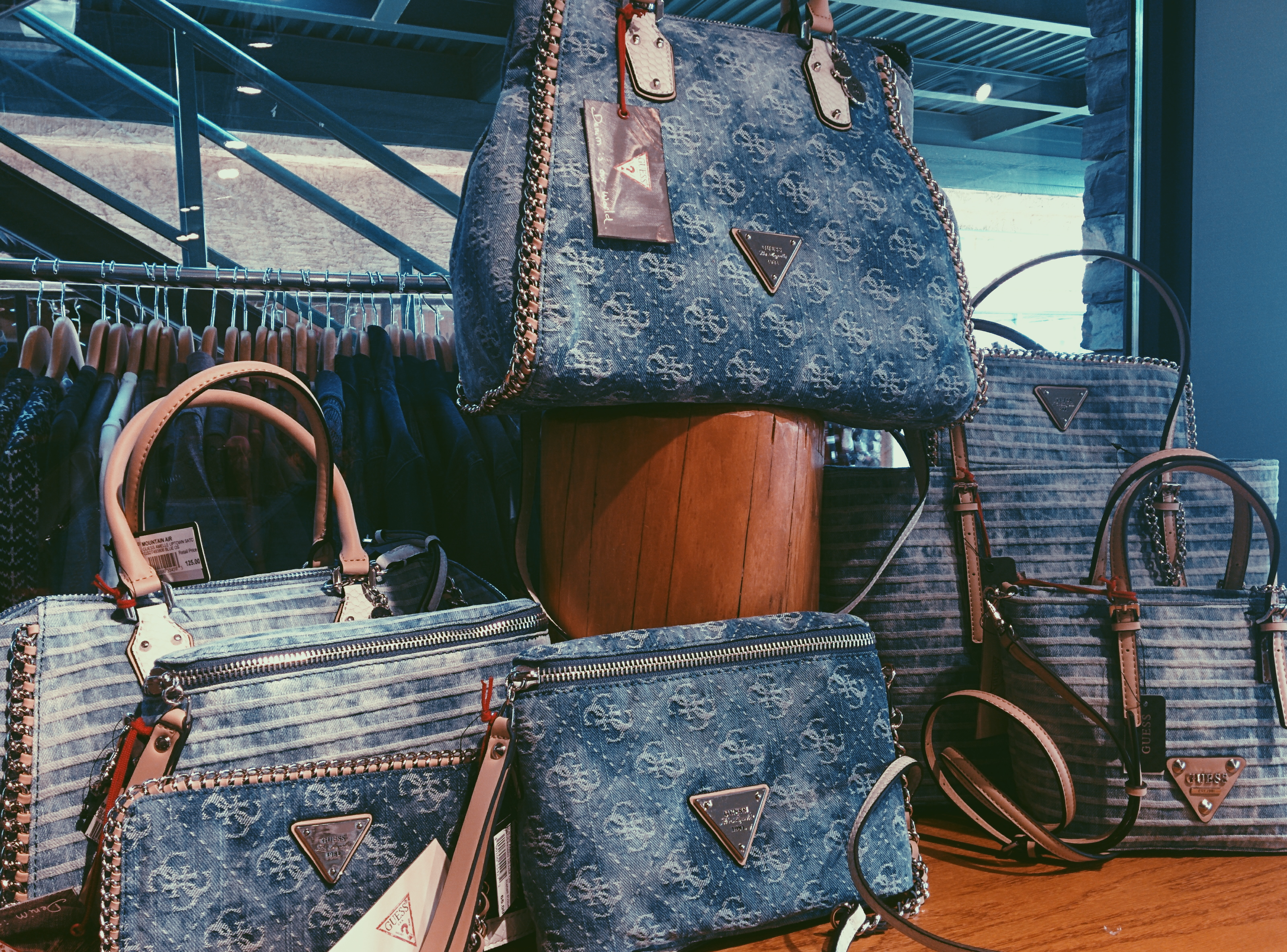 new guess bags in acid wash blue denim our favourite by far is the